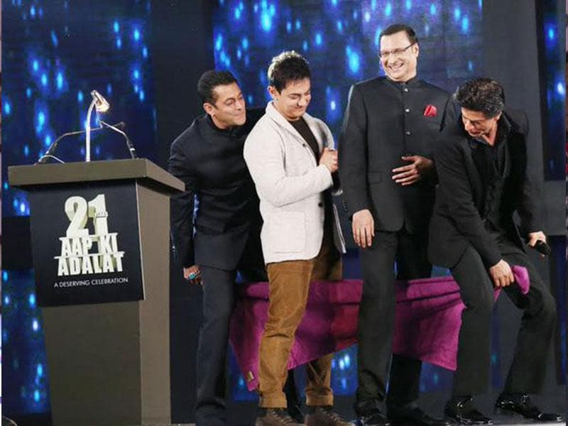 Three's company, four is actually fun. Actor Aamir Khan, Salman Khan and Shah Rukh Khan during a programme organised to celebrate 21 years of a TV show at Pragati Maidan in New Delhi on Dec 2, 2014. (IANS)