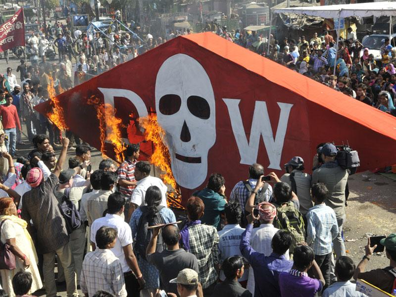 Gas tragedy survivors and social activists burn a poster of Dow Chemical in front of Union Carbide factory in Bhopal on the 30th anniversary of the disaster. (Praveen Bajpai/HT photo)