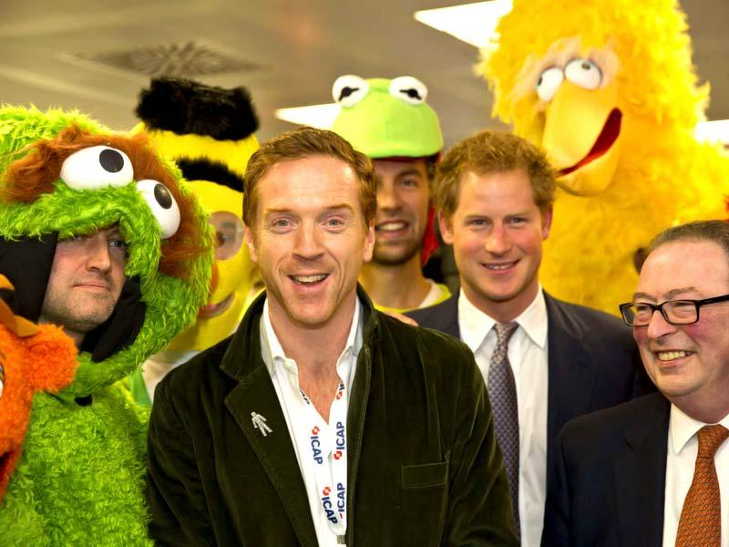 Britain's Prince Harry poses with actor Damian Lewis (centre)during a charity event in London. (Reuters)