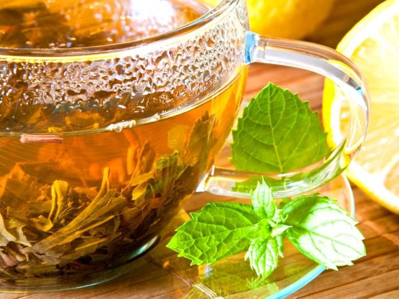 Serve yourself some peppermint tea: Your mom was on to something when she offered a cup of this stuff whenever you had tummy troubles. Joseph says sipping on a cup of peppermint tea can help to ease bloating, cramps and nausea.