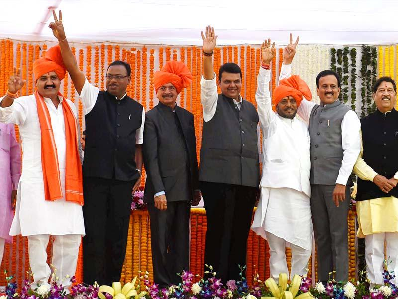 Maharashtra CM Devendra Fadnavis along with Shiv Sena ministers during their swearing-in ceremony in Mumbai. (PTI photo)