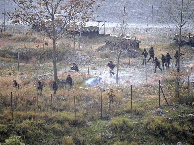 Indian Army personnel search for suspected militants as smoke rises from a bunker after a gun battle in Uri on Friday. (Reuters)