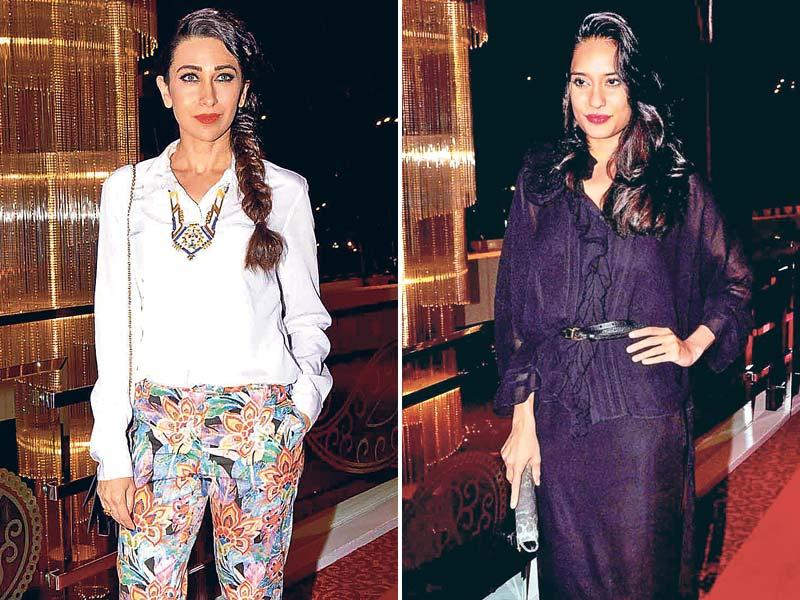 Bollywood divas upped the glamour quotient at this art exhibition in Mumbai over the weekend. Actor Karisma Kapoor looked stunning in a pair of printed trousers that she had teamed with a white top and red lip colour. Actor Lisa Haydon was ­spotted rocking a stylish black number with magenta lipstick. (HT Photo)