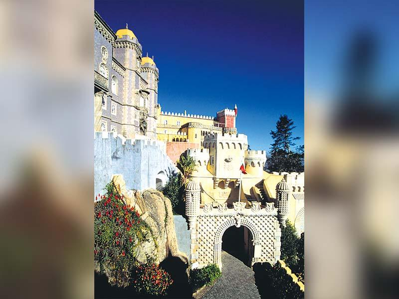 The Pena National Palace, Sintra, Portugal: A Unesco World Heritage site, The Pena National Palace stands tall atop a hill in Sintra. Considered as a national monument, the palace, which almost entirely stands on rock, represents expressions of 19th-century Romanticism.