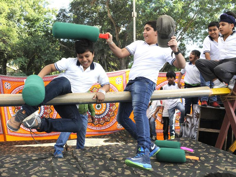 Students enjoy playing a game at a carnival for children at Daly College in Indore on Sunday. (Amit K Jaiswal/HT photo)
