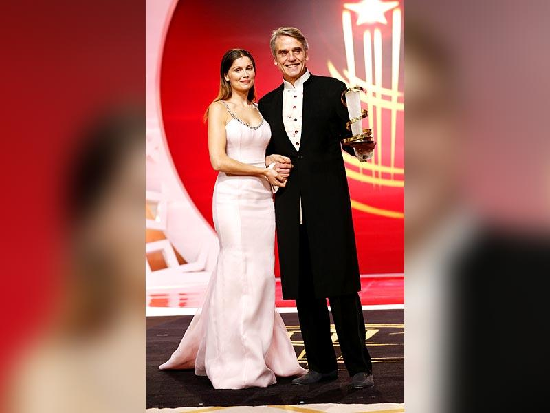 Actor Laetitia Casta presents Jeremy Irons with a tribute award at the 14th Marrakech International Film Festival, December 6, 2014. (Reuters)