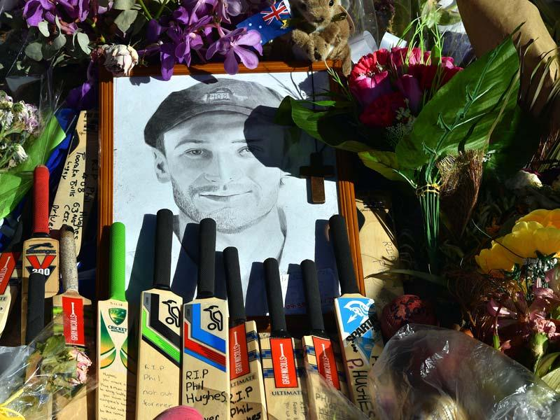 Bats and caps are left outside the stadium in a tribute to the late Phillip Hughes prior to the first day's play in the first Test match between Australia and India at Adelaide Oval in Adelaide. (AFP Photo)