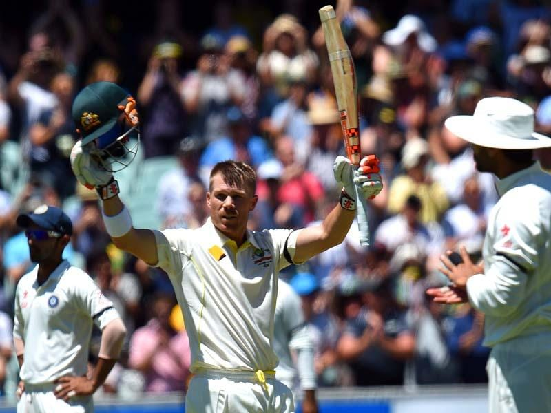 Australia's David Warner celebrate his century on the first day of the first Test match between Australia and India at Adelaide Oval in Adelaide. (AFP Photo)
