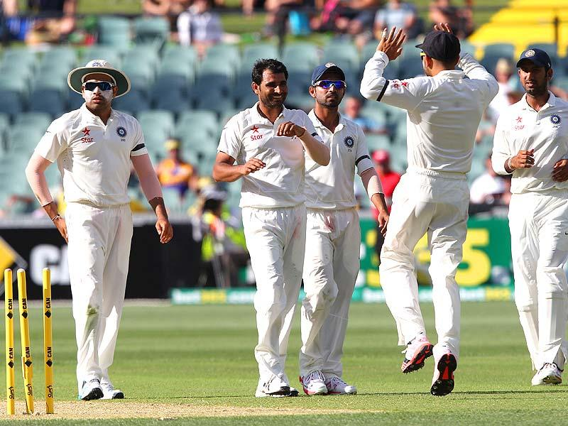 India's Mohammed Shami celebrates the wicket of Australia's Nathan Lyon during the first day of the first Test between Australia and India in Adelaide. (AP Photo)