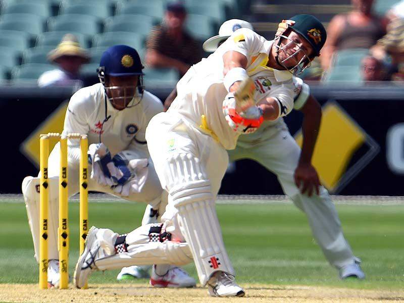 Australia's David Warner fails to clear the boundary and loses his wicket to India's leg-spinner Karn Sharma on the first day of the first Test match between Australia and India at Adelaide Oval in Adelaide. (AFP Photo)