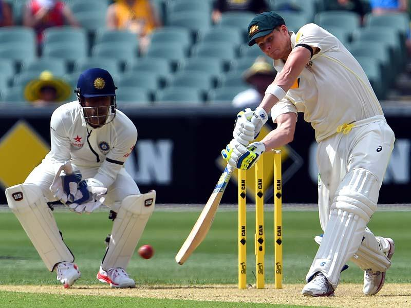 Australia's Steven Smith plays a shot against India on the first day of the first Test match between Australia and India at the Adelaide Oval. (AFP Photo)