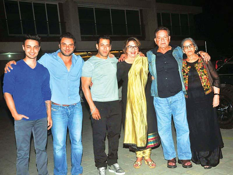 Salman Khan celebrated his mother Salma Khan's birthday at Arpita Khan's new home. Barring a few members, the entire Khan family was present at the do. Salman was in a jovial mood and posed outside Arpita's apartment to pose for pictures. He was even very warm towards the photographers, and offered to order dinner for them. Arpita later posted a picture of herself with sister Alvira Khan and Salman on Twitter. (All photos: Viral Bhayani)