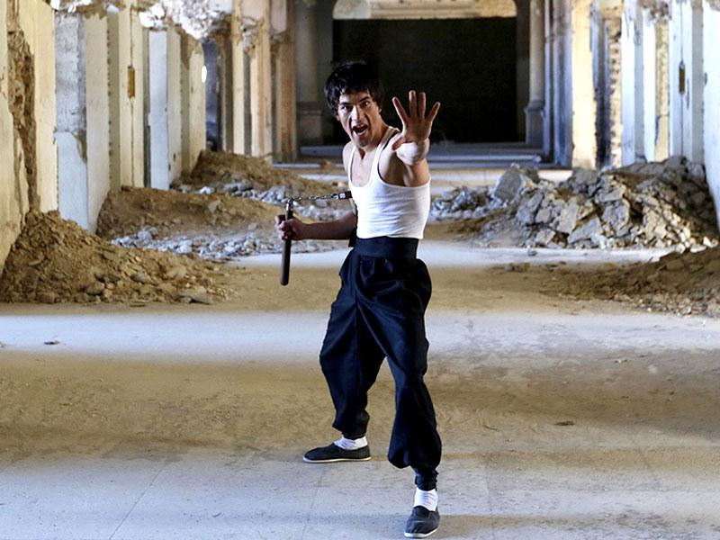 From the ruins of a bombed-out palace above Kabul, Abbas Alizada, a 20-year-old Afghan man bearing a striking resemblance to kung fu legend Bruce Lee is high-kicking his way to Internet fame. (Reuters Photo)