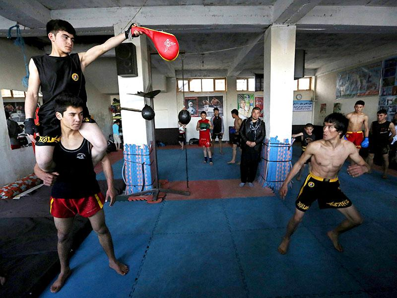 Alizada trains twice a week, swirling nunchakus and sporting a Lee-like bowl haircut in Kabul's desolate Darulaman palace.(Reuters Photo)