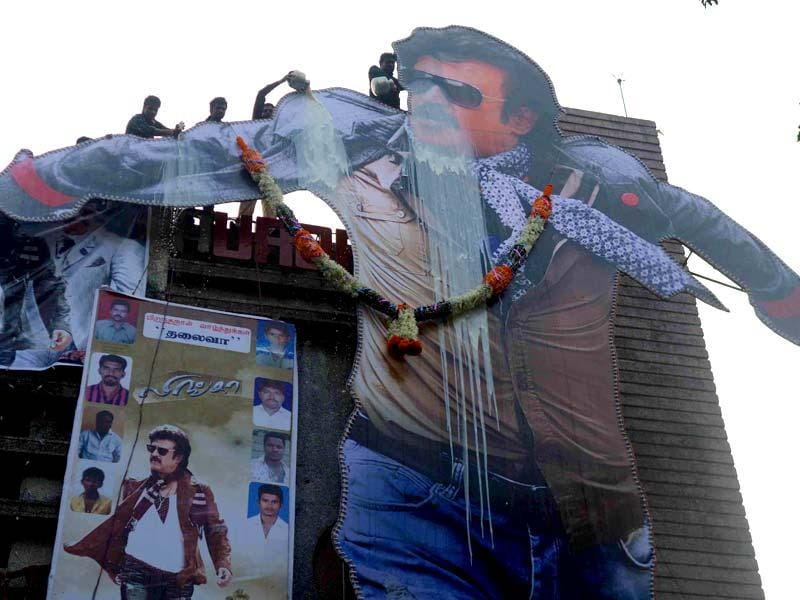 Rajinikanth fans pouring milk on a his cut-out in Mumbai. (Photo: Sandeep Mahankal/IANS)