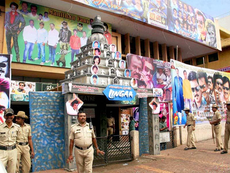 Security personnel keep vigil at theatres following the release of Rajinikanth starrer 'Linga' in Bengaluru on Friday. PTI Photo