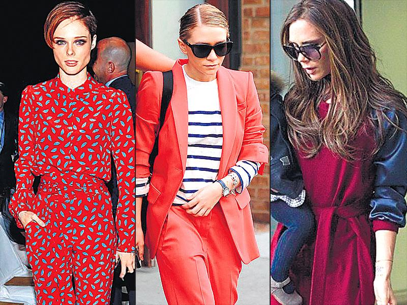 Model Coco Rocha carries off a printed red jumper (L), Designer Ashley Olsen peps up the pantsuit with a striped top (C), Designer Victoria Beckham opts for a plum head-to-toe chic look (R).