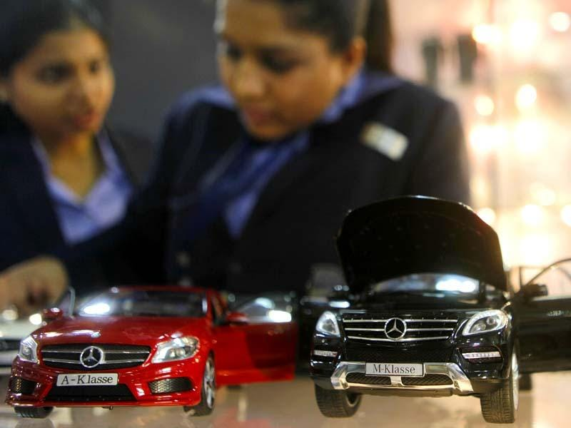 Miniature versions of cars are displayed at the Autocar Performance Show 2014 at BKC in Mumbai.(Pratham Gokhale/HT photo)