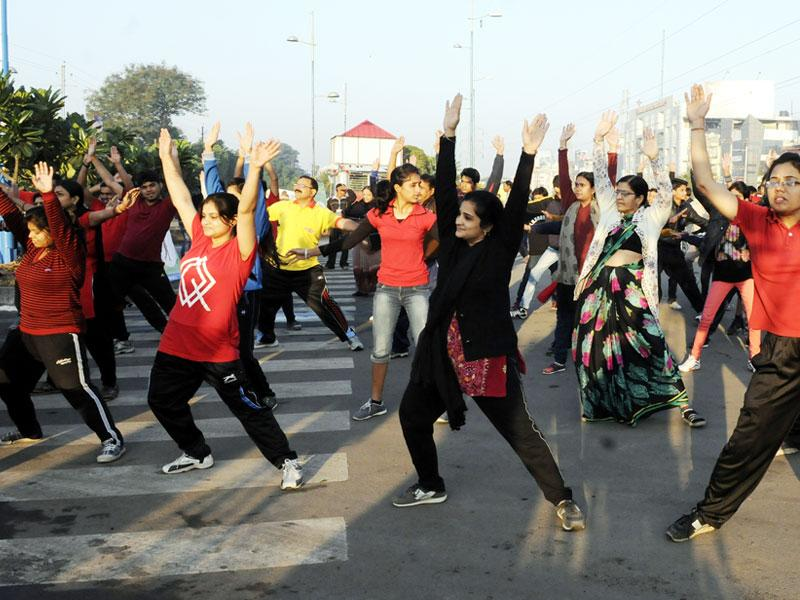 Girls and women exercise on a road in Indore on Sunday during Raahgiri Day which aims at promoting a healthy lifestyle. (Amit K Jaiswal/HT photo)