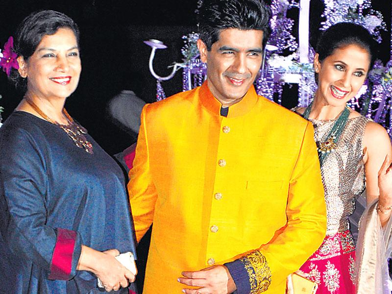 The sangeet ceremony of Riddhi Malhotra and Tejas Talwalkar was a starry affair as several B-Town stars made an appearance, where Manish Malhotra, Urmila Matondkar and Shabana Azmi posed for the shutterbugs. (HT Photo)