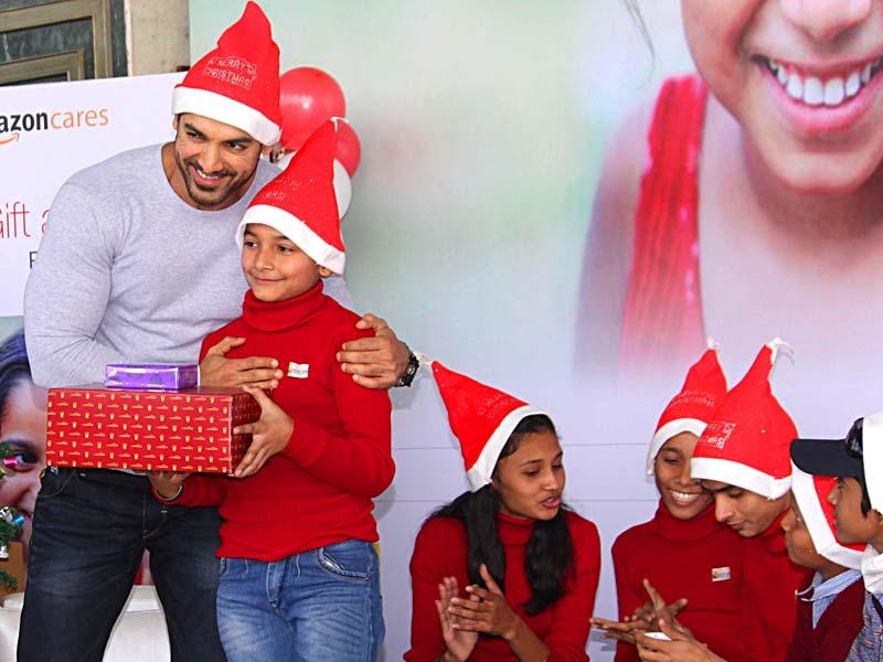 It was an early Christmas for kids in the national capital when Bollywood actor-producer John Abraham turned Santa for the terminally ill and underprivileged children in New Delhi, on Dec 15, 2014. John was seen happily mingling with the kids and presenting gifts to them.(Photo: Amlan Paliwal/IANS)