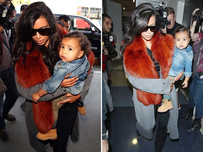 When the mother duo touched down in London recently, they kept it casual. Isn't North West rocking this denim jacket over layered t-shirts and jeans. Don't miss the shoes! Also, see, Kim Kardashian end her style streak of matching mommy-and-me ensembles. While Kim hid behind the flashing lights of the paparazzi in a pair of Saint Laurent sunnies, North seems to be loving all the attention. Cutie!