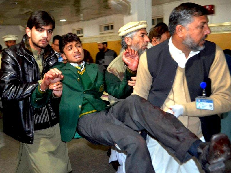 Pakistani volunteers carry a student injured in the Taliban attack on the Army Public School in Peshawar, Pakistan. (AP/PTI Photo)