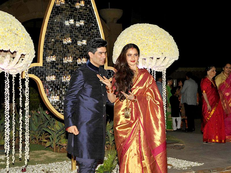 Ace designer Manish Malhotra made sure that Bollywood celebrities attend his niece Rriddhi Malhotra's wedding reception. Here he is seen with Rekha. (Photo: Prodip Guha)