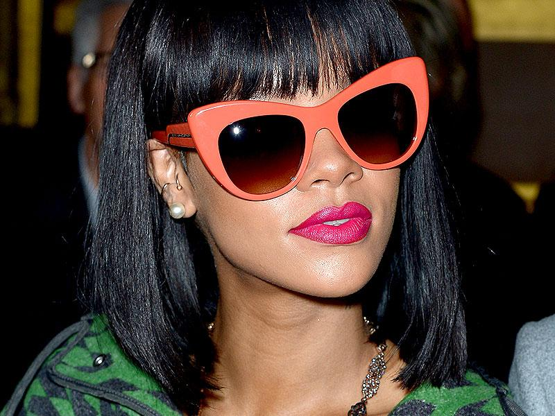 Rihanna's sitting pretty in the front row at Stella McCartney's Fall 2014 show in sherbet shades and shocking-pink lips.
