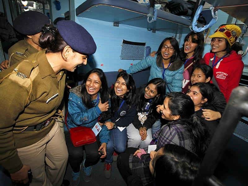 "Students of Delhi University, who are going North East for education visit, shares a light moment with police personnel after boarding a Special Train ""Gyanodaya Dharohar- The Glory of North East"" at Safdarjun Railway station, in New Delhi. (Raj K Raj/HT Photo)"
