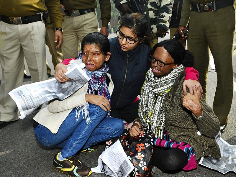 "Acid attack survivors were detained by the Delhi Police outside the Parliament as they gathered to protest against ""the lack of any safeguards and laws seeking their active rehabilitation"" outside the Parliament, in New Delhi. (Vipin Kumar/HT Photo)"