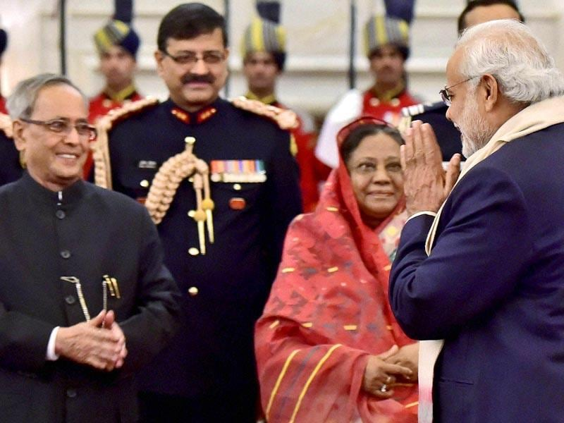 President Pranab Mukherjee is greeted by Prime Minister Narendra Modi during a banquet hosted in honour of Bangladesh President Abdul Hamid at Rashtrapati Bhavan in New Delhi on Friday. (PTI Photo)