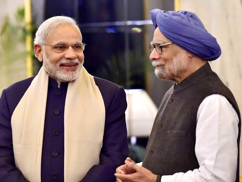 Prime Minister Narendra Modi talks with former prime minister Manmohan Singh during a banquet in honour of Bangladesh President Abdul Hamid at Rashtrapati Bhavan in New Delhi. (PTI Photo)