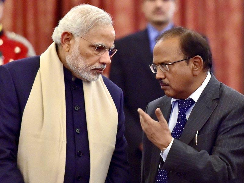Prime Minister Narendra Modi talks with National Security Advisor (NSA) Ajit Doval during a banquet in honour of Bangladesh President Abdul Hamid at Rashtrapati Bhavan in New Delhi. (PTI Photo)