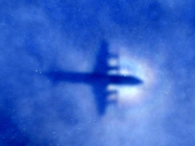 The shadow of a Royal New Zealand Air Force (RNZAF) P3 Orion maritime search aircraft is seen on low-level clouds as it flies over the southern Indian Ocean looking for missing Malaysian Airlines flight MH370. (Reuters Photo)