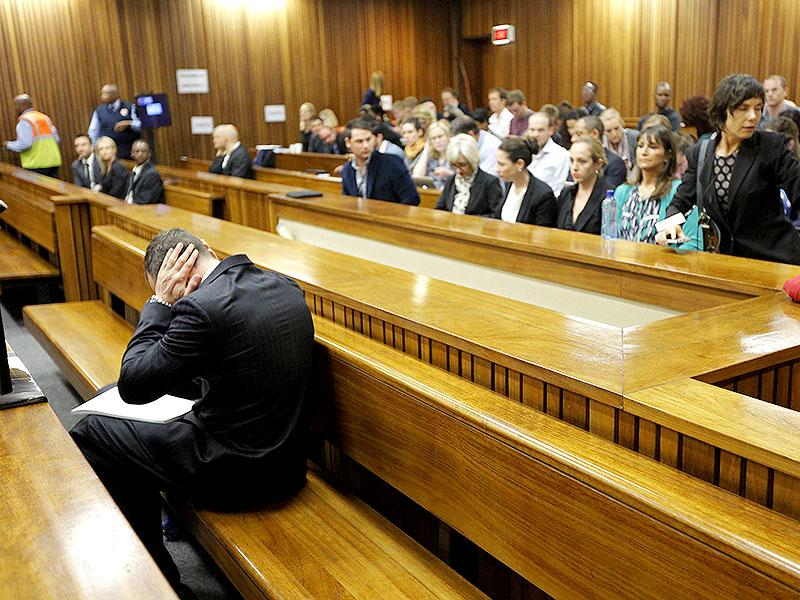 Olympic and Paralympic track star Oscar Pistorius sits in the dock ahead of the second day of his trial for the murder of his girlfriend Reeva Steenkamp at North Gauteng High Court in Pretoria. (Reuters Photo)