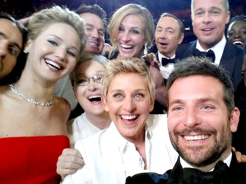 This image released by Ellen DeGeneres shows actors front row from left, Jared Leto, Jennifer Lawrence, Meryl Streep, Ellen DeGeneres, Bradley Cooper, Peter Nyong'o Jr., and, second row, from left, Channing Tatum, Julia Roberts, Kevin Spacey, Brad Pitt, Lupita Nyong'o and Angelina Jolie as they pose for a