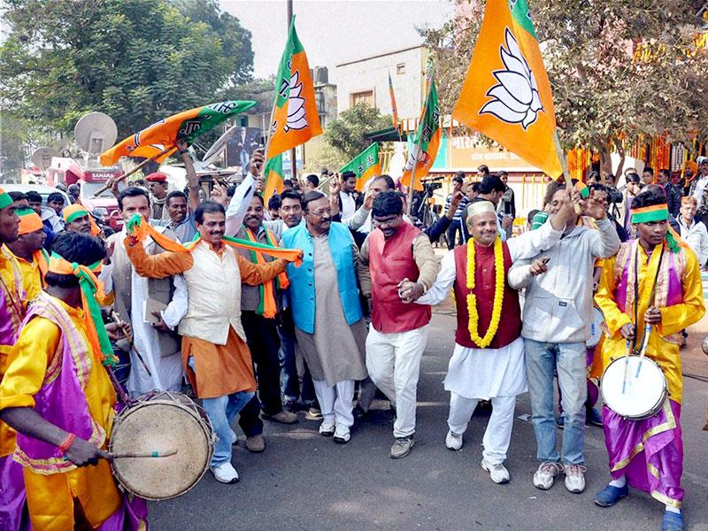 BJP Party workers celebrate after Jharkhand Assembly election results are declared, at the state party office in Ranchi on Tuesday. (PTI Photo)