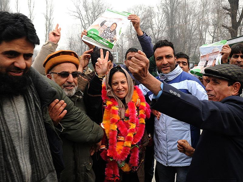 Peoples Democratic Party (PDP) candidate Asiya Naqash gestures after winning the Hazratbal constituency, in Srinagar on Tuesday. (AFP Photo)