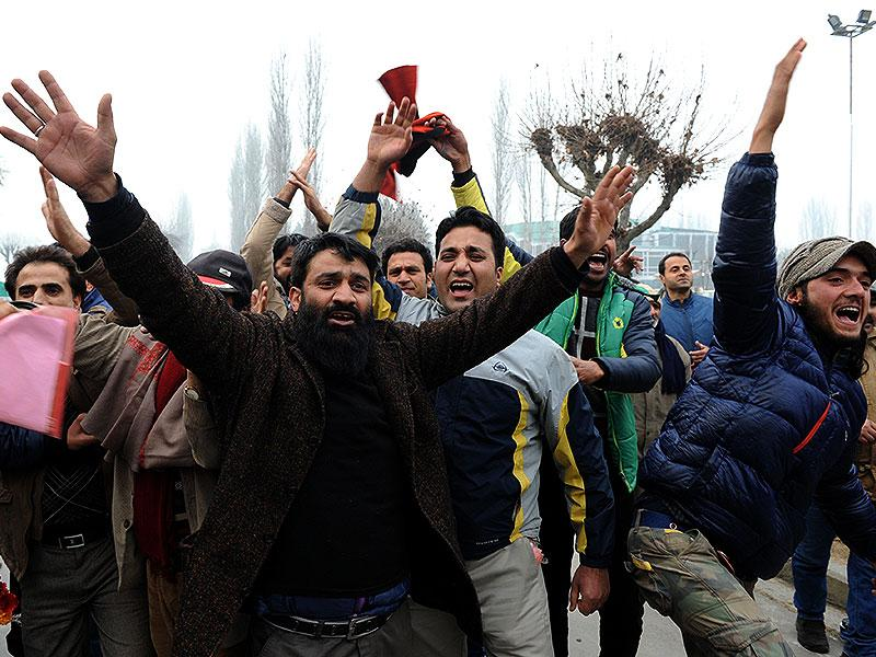 Peoples Democratic Party (PDP) supporters shout slogans after PDP candidate Mohd Ashraf defeats incumbent Jammu and Kashmir chief minister Omar Abdullah for the Sonwar constituency, in Srinagar Tuesday. (AFP Photo)