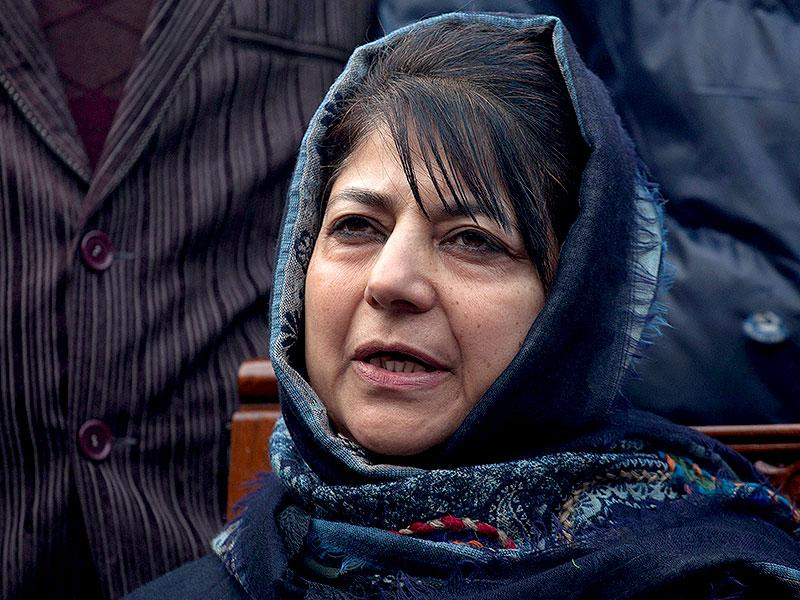 PDP leader Mehbooba Mufti addresses the media at her residence in Srinagar. The PDP won 28 seats and emerged as the single largest party in the J-K polls. (AP Photo)