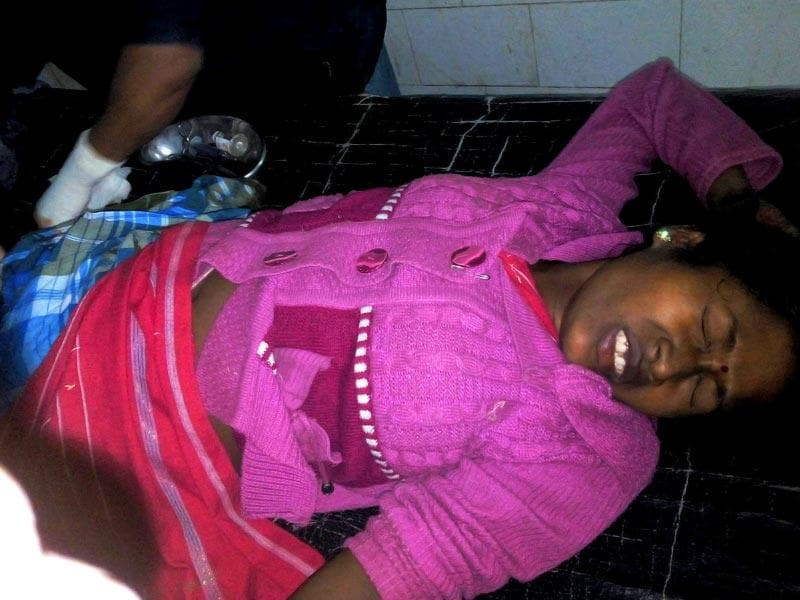 An injured woman being treated at a hospital after the NDFB (S) militants' attack at four places in Sonitpur and Kokrajhar districts in Assam, killing more than 60 people. (PTI Photo)