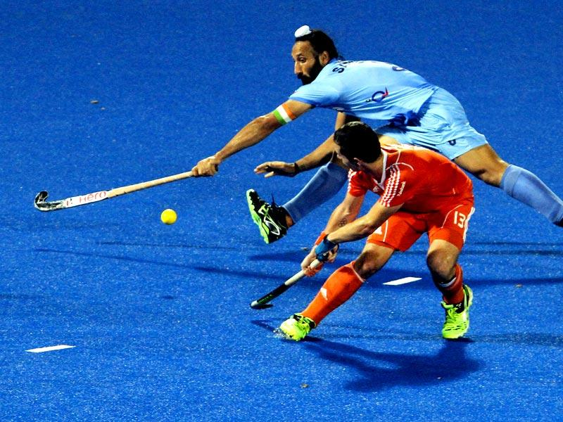 Sardar Singh of India and Sander Baart of Netherlands in action during the Hero Champions Trophy 2014 at Kalinga Stadium in Bhubaneswar, Odisha. (Virendra Singh Gosain/HT Photo)