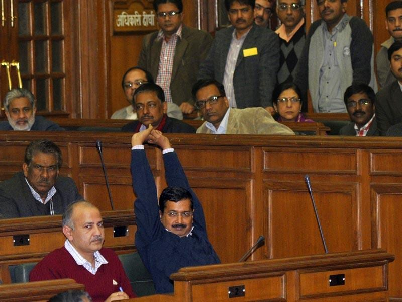 Arvind Kejriwal stretches during proceedings at the Delhi Legislative assembly. Kejriwal resigned as Delhi's chief minister in 49 days. (Vipin Kumar/HT Photo)