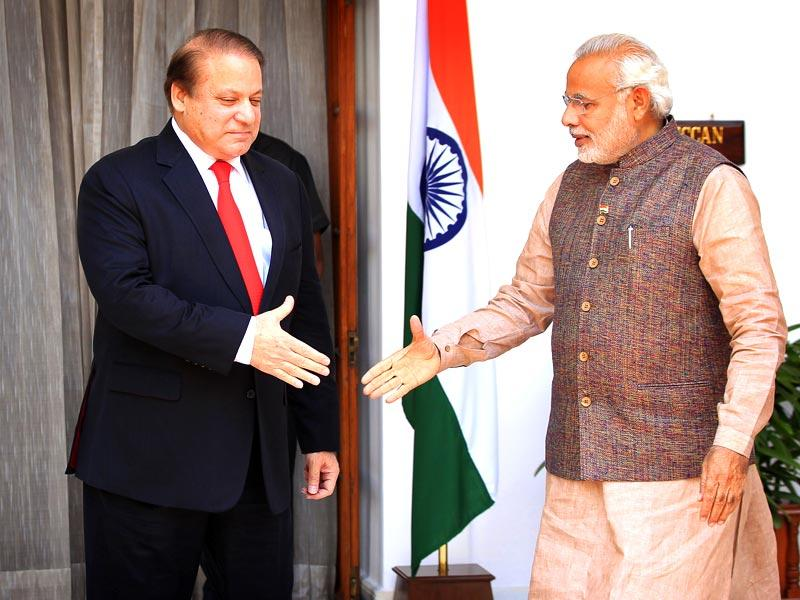 Pakistan's prime minister Nawaz Sharif shakes hand with Indian Prime minister Narendra Modi prior to a meeting at Hydrabad House in New Delhi. (Ajay Aggarwal/HT Photo)