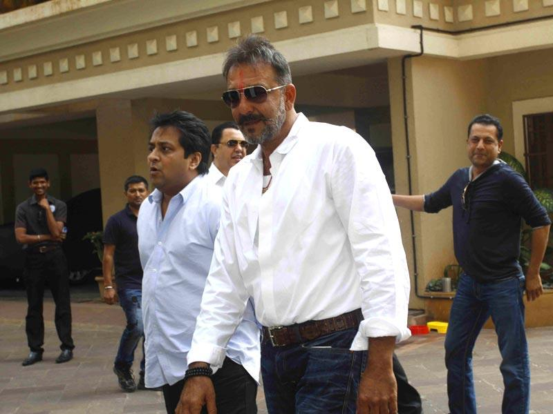 Sanjay Dutt, who was granted furlough for 14 days, at his residence Imperial Heights, Pali Hill Bandra in Mumbai on Dec 24, 2014. The actor is currently serving the remaining of his three-and-a-half-year sentence in a 1993 Bombay blasts case in Pune's Yerwada jail. (Photo:IANS)