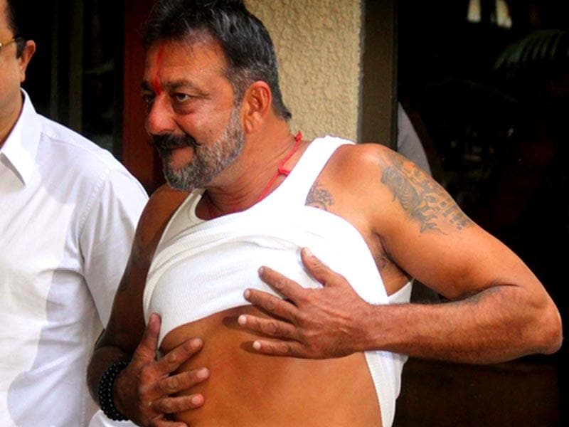 And Sanjay Dutt literally shows off his body for the shutterbugs after he was granted two weeks' furlough by the state prison authorities in Mumbai on Wednesday. (PTI Photo)