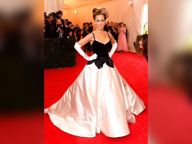 Sarah Jessica Parker: At the Met Gala event this year Sarah Jessica Parker sauntered up the steps in a black and ivory Oscar de la Renta gown.