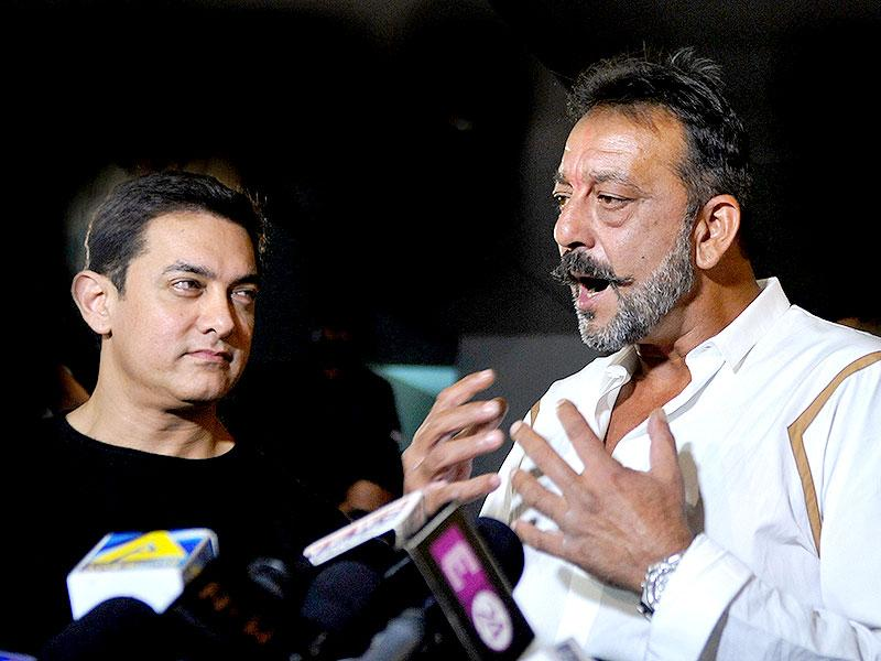 Sanjay Dutt, on two weeks furlough from his prison sentence, speaks to journalists with Aamir Khan as they attend a special screening PK in Mumbai. (AFP Photo)