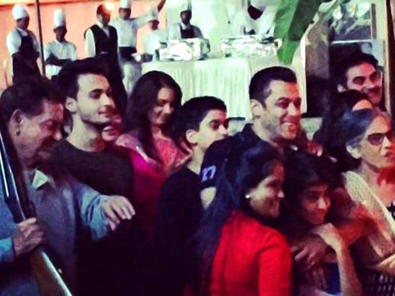 Salman Khan surrounded by his family as his birthday celebrations begin Friday night with the cutting of a strawberry and chocolate cake. A host of big ticket celebs are part of the celebrations. (Courtesy: Twitter)